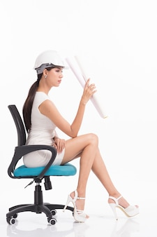 Sexy girl structural engineer working on white