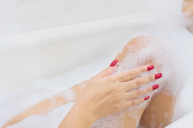 Sexy girl in white bathtub