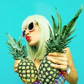Sexy girl with pineapple. hot beach party style
