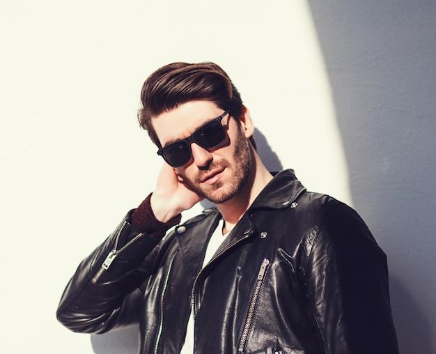 Sexy gorgeous stylish man in leather jacket