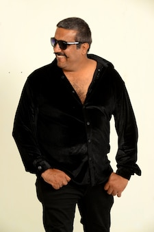 Sexy handsome indian  with moustache  wearing black outfit
