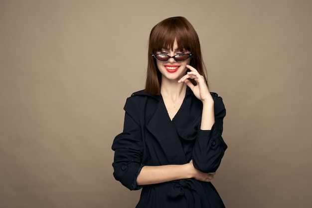 Sexy lady fashionable clothes good mood smiling on a beige background portrait
