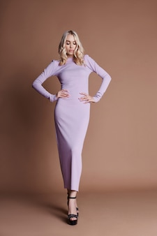 Sexy luxurious woman in a dress. autumn collection