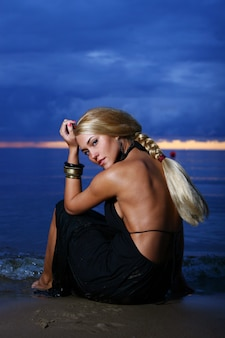 Sexy and luxury woman on the sunset