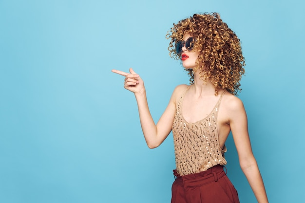 Sexy model curly hair shows her finger