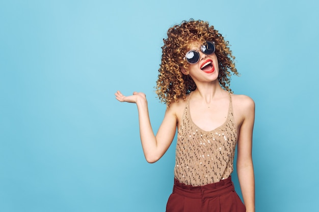 Sexy model red lips curly hair copy space hand gesture bright makeup