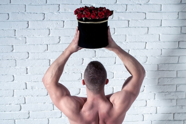 Sexy muscular man with roses