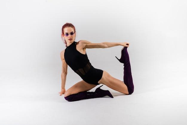Sexy pole redhead dancer showing her beautiful body