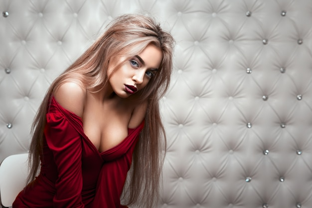 Sexy portrait of a blond in red dress