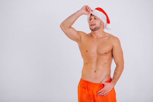 Sexy santa man isolated on white background