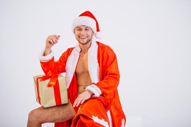 Sexy santa man isolated on white background