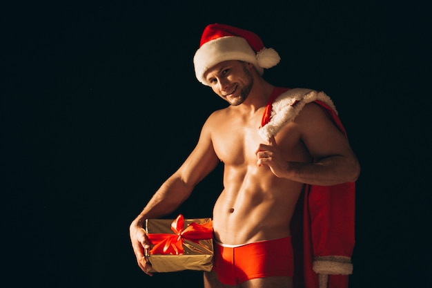 Sexy santa man naked on black background