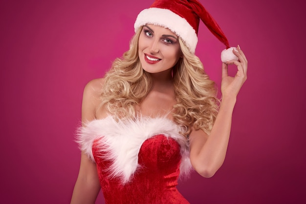 Santa sexy sullo sfondo rosa