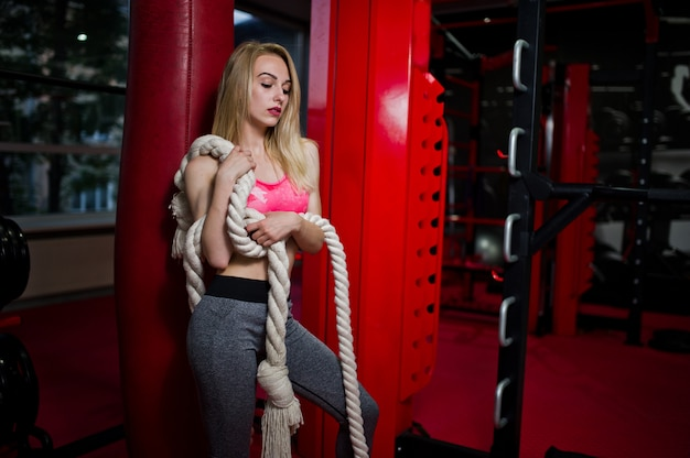 Sexy sport blonde girl boxer with rope.