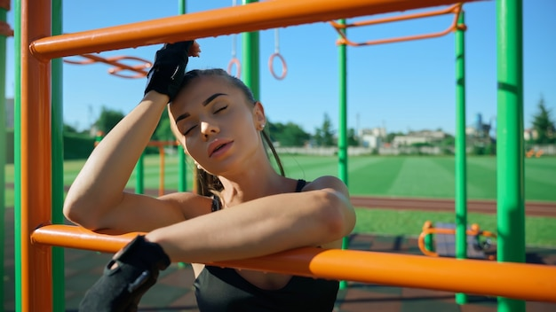 Sexy sportswoman posing at sports ground