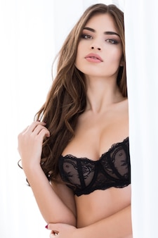 Sexy woman in black lingerie looking at camera