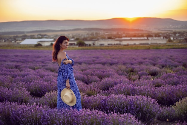 Sexy woman in blooming lavender fields sunset enjoying nature