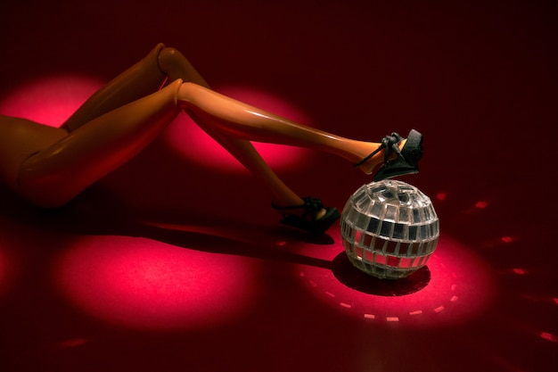 Sexy woman figurine with disco ball lying