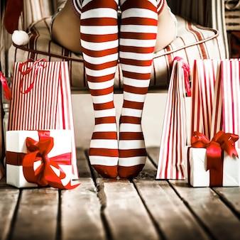 Sexy woman legs. christmas concept