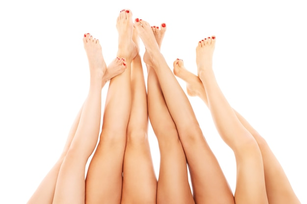 Sexy woman legs pointing up over white background