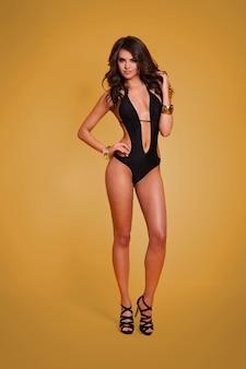 Sexy woman in luxurious swimwear