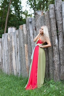 Sexy woman outdoor with nice colorful dress. fashion