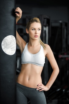 Sexy woman posing at the gym