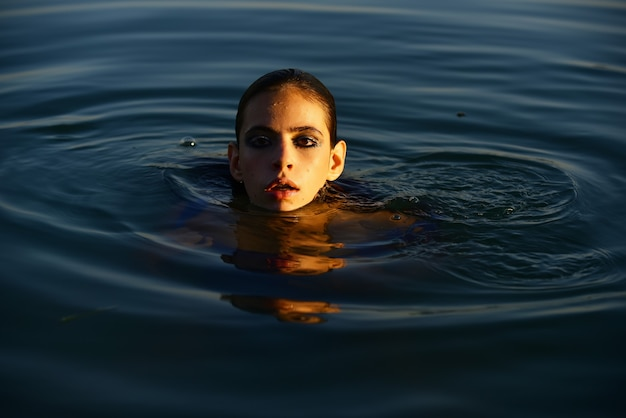 Sexy woman posing in water. summertime. sensual girl summer portrait. beauty female.