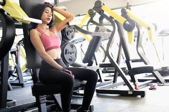 Sexy woman Resting After Exercises In Gym