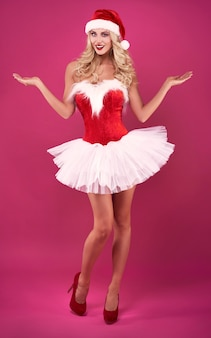 Sexy woman in santa claus costume