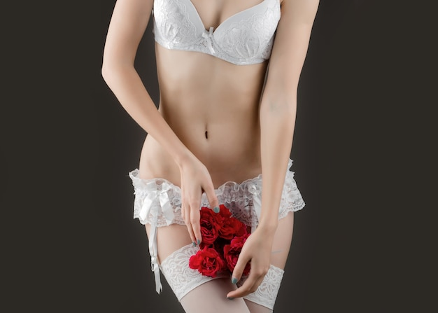 Sexy woman in stockings with red rose