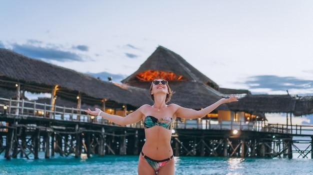 Sexy woman in swim wear by the ocean