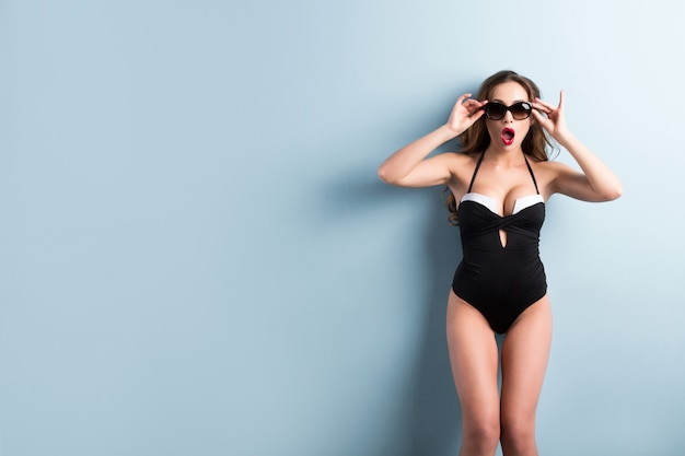 Sexy woman in swimsuit and sunglasses.
