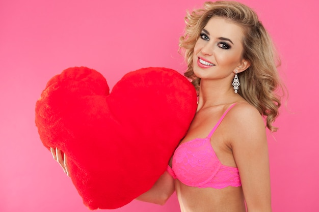 Sexy woman in underwear and big heart. happy valentine's day concept