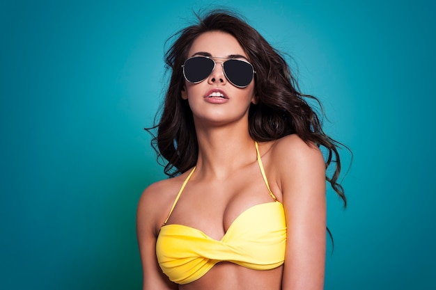 Sexy woman wearing fashion glasses in summer time