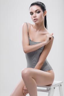 Sexy woman with a beautiful body in bikini
