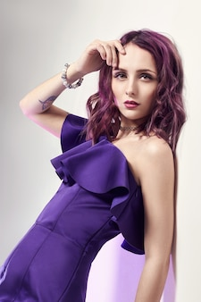 Sexy woman with purple hair and a purple dress