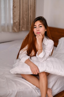 Sexy women concept. sexy asian girls are playing in the bedroom.