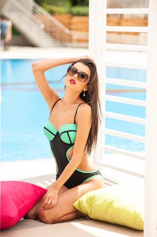 Sexy young woman near the swimming pool