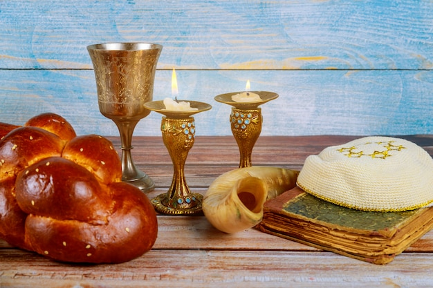 Shabbat challah bread, shabbat wine and candles on the table