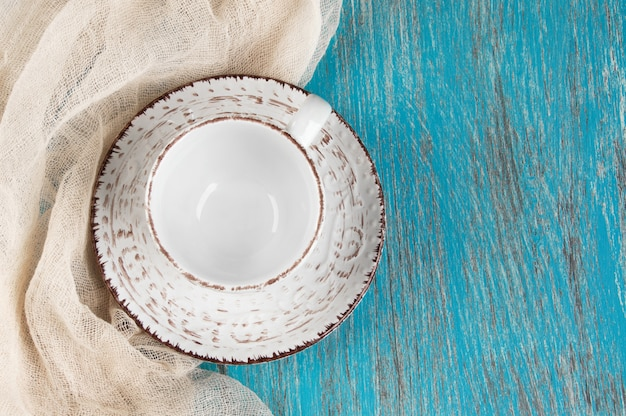 Shabby beige cup and saucer