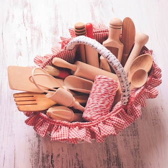 Shabby chic rustic basket with wooden kitchen utensils
