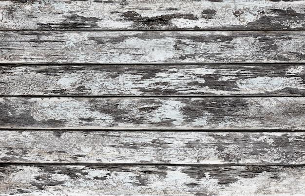 Потертый старый выветрившийся деревянный деревенский грубый серый окрашенный фон