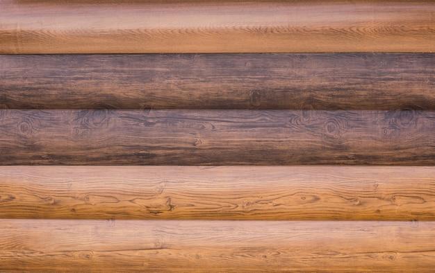 Потертые старые выветривания деревянные деревенские стены