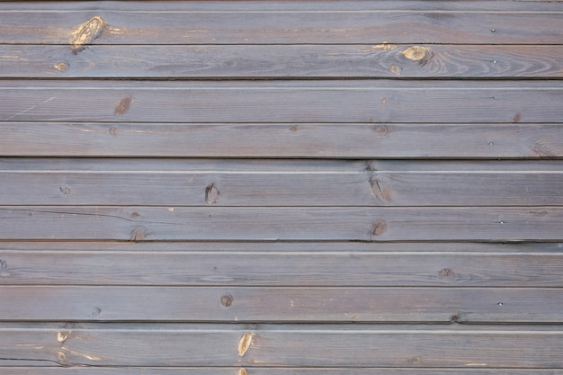 Shabby wooden wall carpentry boards panel surface of wood texture grey and purple horizontal plank