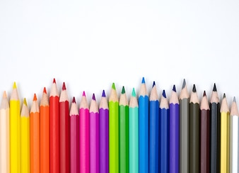Shades of color pencils isolated on white fabric canvas background