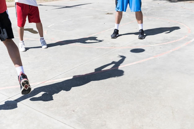 Shadow of basketball player on an outdoors court