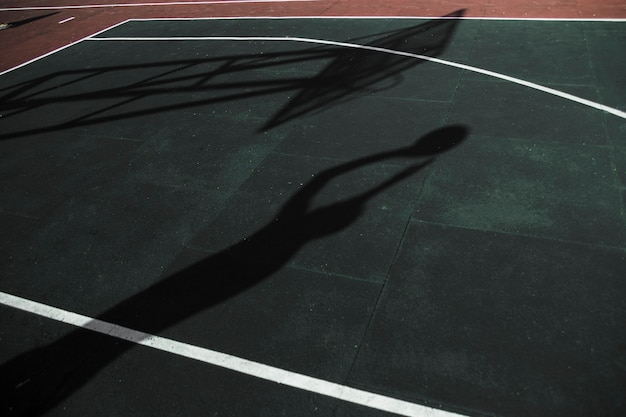 Shadow of basketball player training