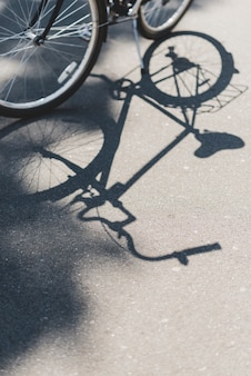 Shadow of bicycle on road