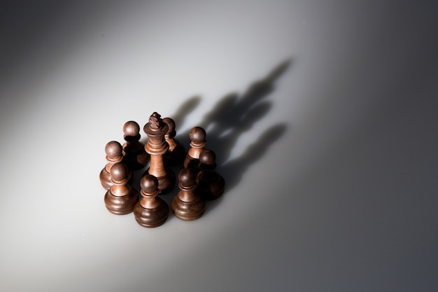 Shadow of chess pieces lokk like a king crown